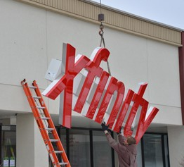 Xfnity sign rises at new Xfinity store located at 1229 E. Golf Rd. in Schaumburg, IL.